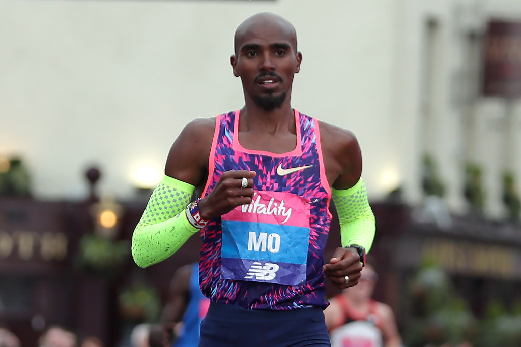 Britain's Mo Farah gestures after crossing the finish line and winning the half marathon elite men's race during the inaugural The Big Half in London on March 4, 2018. / AFP PHOTO / Daniel LEAL-OLIVAS (Photo credit should read DANIEL LEAL-OLIVAS/AFP/Getty Images)