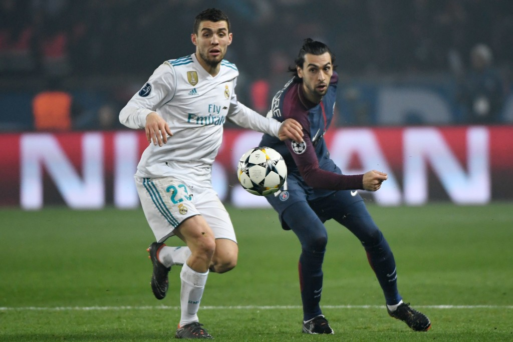 Real Madrid's Croatian midfielder Mateo Kovacic (L) vies for the ball with Paris Saint-Germain's Argentinian midfielder Javier Pastore during the UEFA Champions League round of 16 second leg football match between Paris Saint-Germain (PSG) and Real Madrid on March 6, 2018, at the Parc des Princes stadium in Paris. / AFP PHOTO / CHRISTOPHE SIMON (Photo credit should read CHRISTOPHE SIMON/AFP/Getty Images)