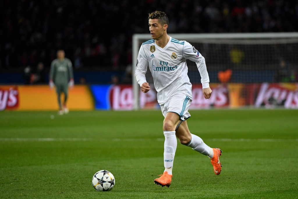 Real Madrid's Portuguese forward Cristiano Ronaldo controls the ball during the UEFA Champions League round of 16 second leg football match between Paris Saint-Germain (PSG) and Real Madrid at The Parc des Princes Stadium in Paris on March 6, 2018. / AFP PHOTO / Christophe SIMON (Photo credit should read CHRISTOPHE SIMON/AFP/Getty Images)