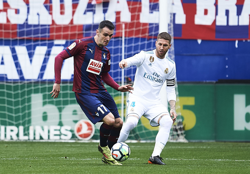 EIBAR, SPAIN - MARCH 10: Kike Garcia of SD Eibar duels for the ball with Sergio Ramos of Real Madrid during the La Liga match between SD Eibar and Real Madrid at Ipurua Municipal Stadium on March 10, 2018 in Eibar, Spain . (Photo by Juan Manuel Serrano Arce/Getty Images)