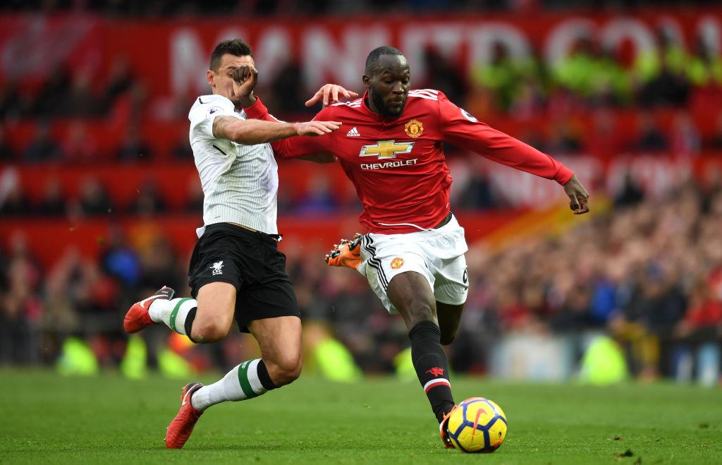 Dejan Lovren battles for the ball with Romelu Lukaku