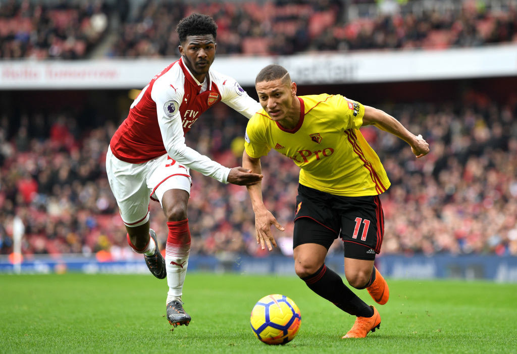 Ainsley Maitland-Niles (l) tangles with Richarlison