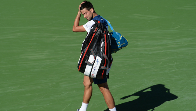 Federer through, Djokovic out at Indian Wells