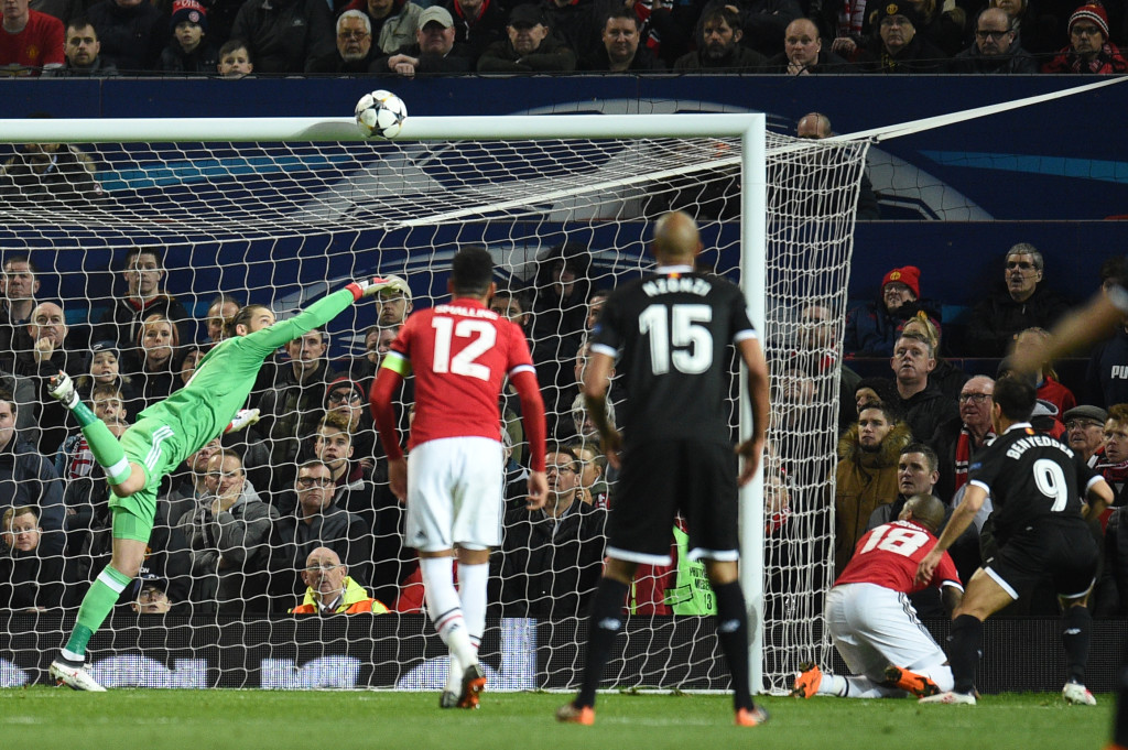 David De Gea tries desperately to keep out Wissam Ben Yedde's second.