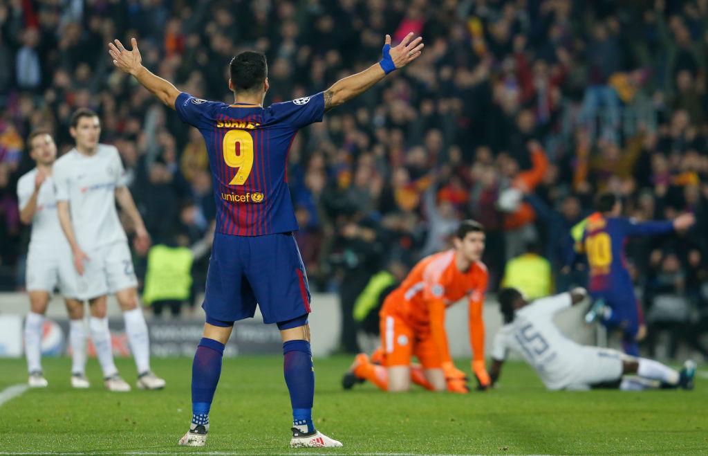 Unsung hero: Luis Suarez celebrates as Lionel Messi does the business