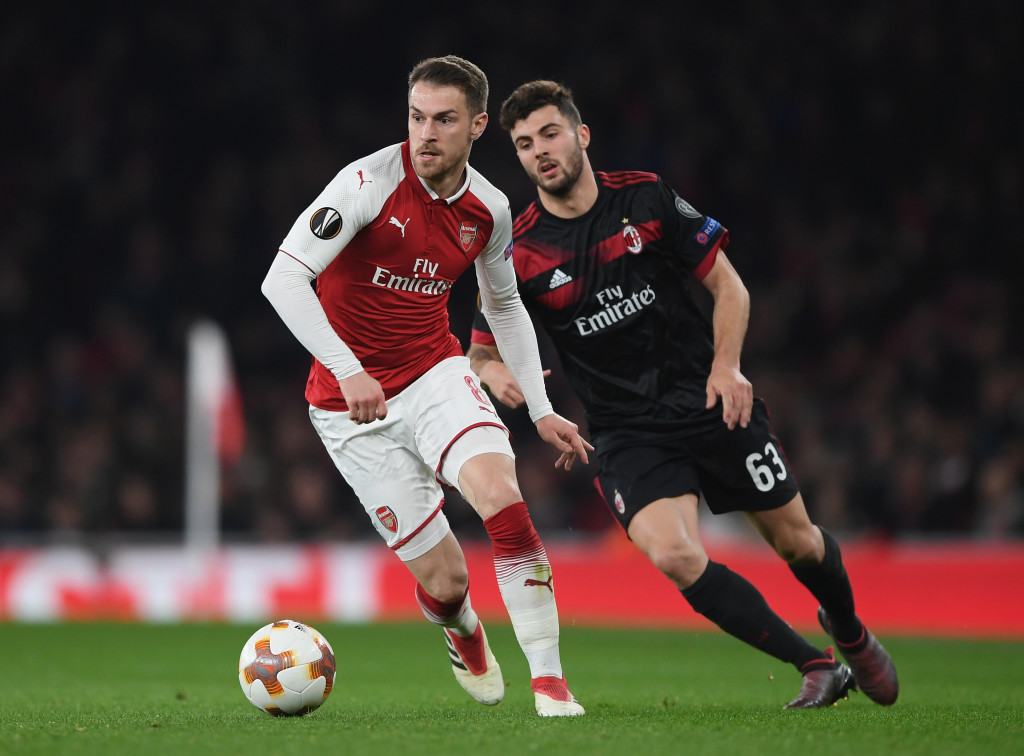 LONDON, ENGLAND - MARCH 15: Aaron Ramsey of Arsenal runs with the ball during the UEFA Europa League Round of 16 second leg match between Arsenal and AC Milan at Emirates Stadium on March 15, 2018 in London, England. (Photo by Shaun Botterill/Getty Images)