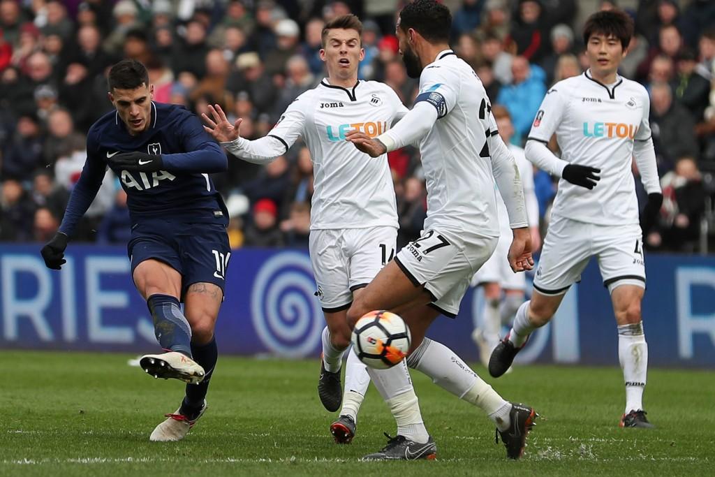 Tottenham Hotspur's Argentina midfielder Erik Lamela (l) scores at Swansea.