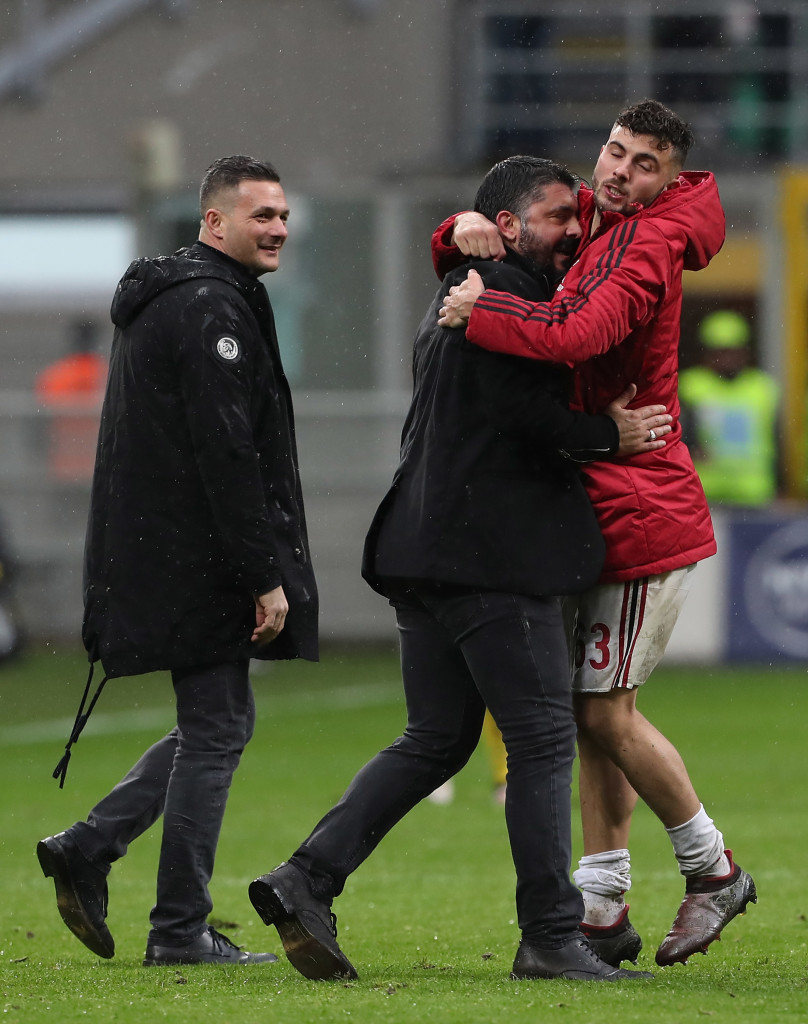 AC Milan coach Gennaro Gattuso embraces Patrick Cutrone at the end of the match between AC Milan and Chievo.