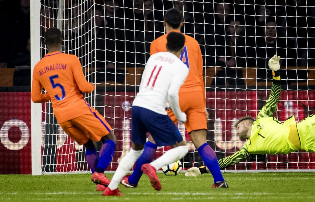 England's Jesse Lingard scores the solitary goal against the Netherlands.