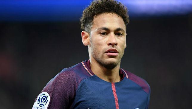 Neymar Jr looks on