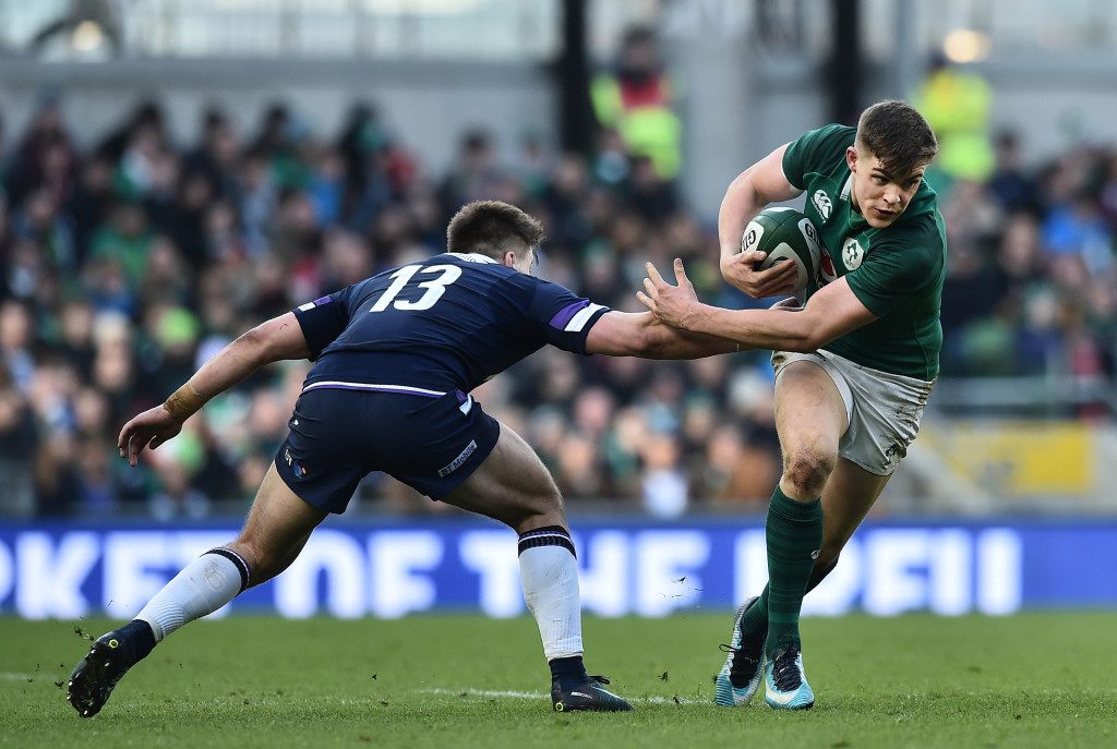 DUBLIN, IRELAND - MARCH 10: Garry Ringrose of Ireland slips past  Huw Jones of Scotland during the Ireland v Scotland Six Nations rugby championship game at Aviva Stadium on March 10, 2018 in Dublin, Ireland. (Photo by Charles McQuillan/Getty Images)