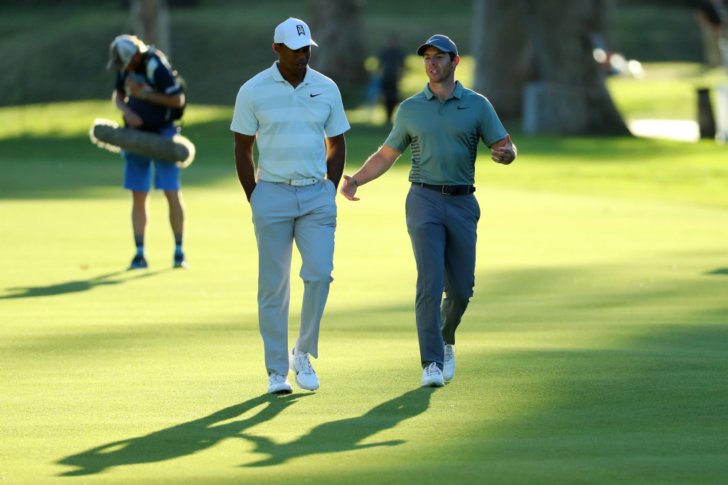PACIFIC PALISADES, CA - FEBRUARY 16: Tiger Woods and Rory McIlroy of Northern Ireland walk across the 17th hole during the second round of the Genesis Open at Riviera Country Club on February 16, 2018 in Pacific Palisades, California. (Photo by Warren Little/Getty Images)