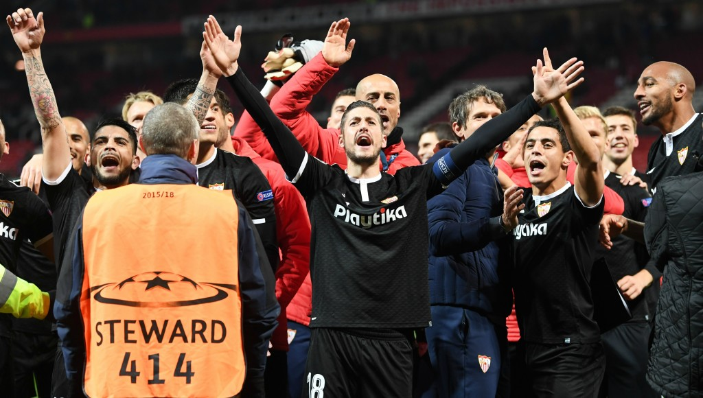 Sevilla celebrate after a maiden European win in England.