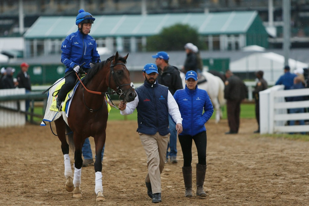 Trainer Saaed bin Suroor leads Thunder Snow back to the barn area prior to the 143rd Kentucky Derby last year.