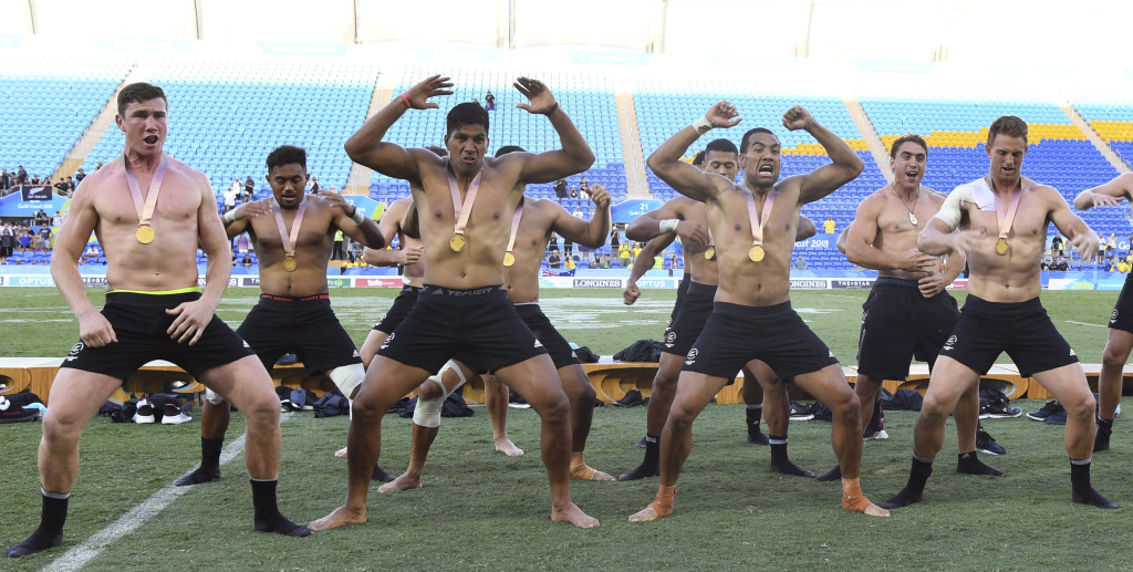 The All Blacks Sevens celebrate with a haka after winning gold.