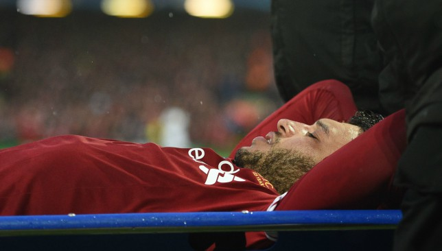 Stretched off: Liverpool and England star Oxlade-Chamberlain.