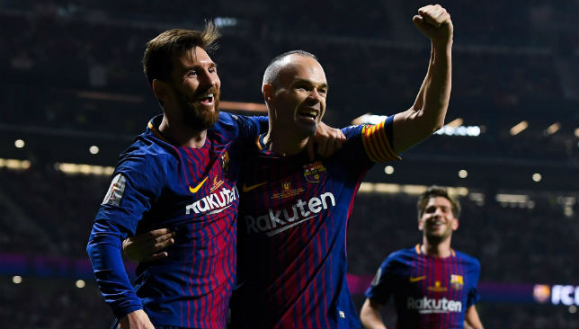 Andres Iniesta of FC Barcelona celebrates with his team mate Lionel Messi