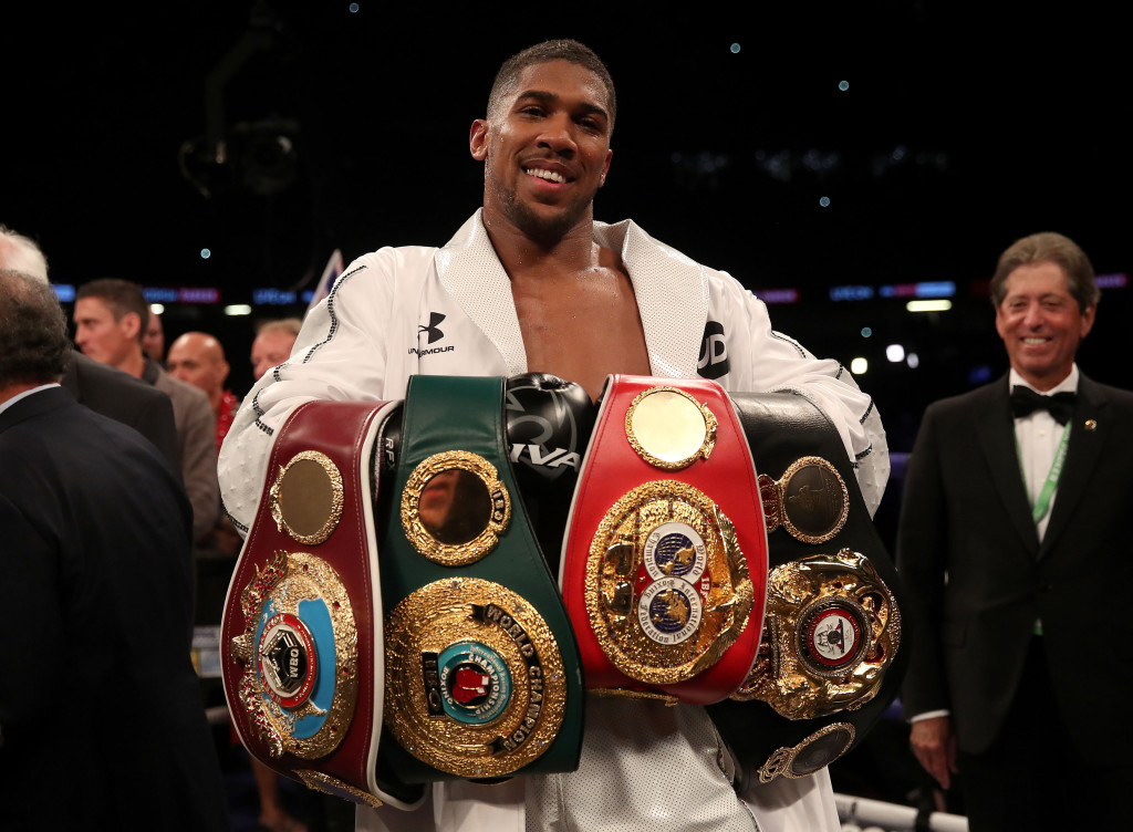 Anthony Joshua celebrates with his belts after victory over Joseph Parker in their WBA, IBF, WBO and IBO Heavyweight Championship contest at the Principality Stadium, Cardiff. PRESS ASSOCIATION Photo. Picture date: Friday March 30, 2018. See PA story BOXING Cardiff. Photo credit should read: Nick Potts/PA Wire