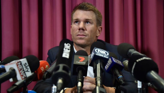David Warner listens to a question