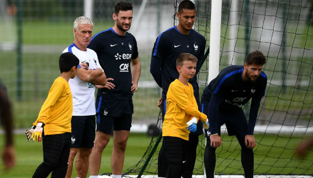 Didier Deschamps (L) speaks with France's goalkeepers Hugo Lloris (C) Alphonse Areola and Benoit Costil (R)
