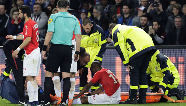 Djibril Sidibe (C) receives medical assistance after an injury.