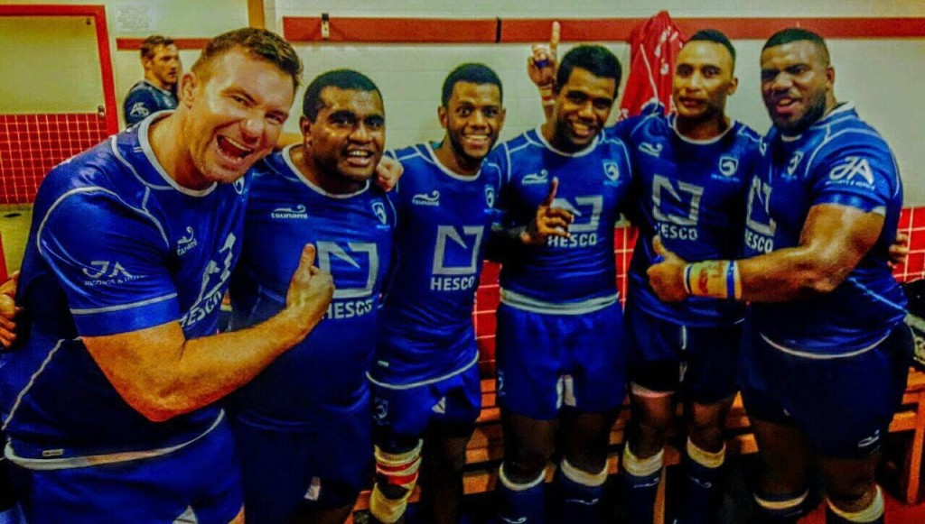Paul Hart (l) celebrates a win over Dubai Exiles with teammates earlier this season.