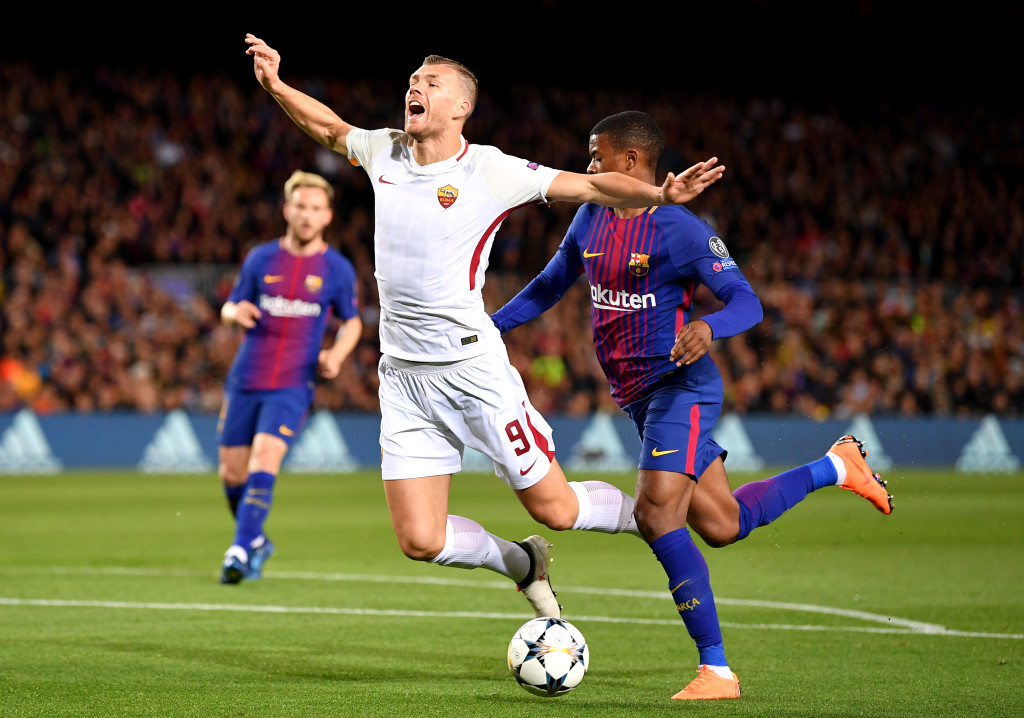 Edin Dzeko of AS Roma thought this should have been a penalty when he was brought down by Nelson Semedo