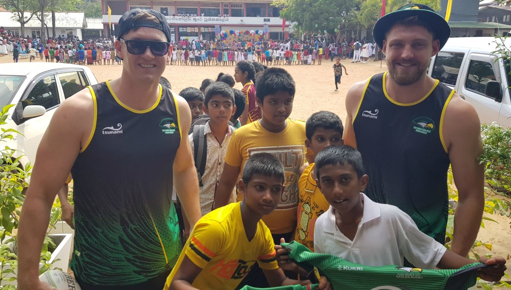 Niall O'Driscoll (l) and Tom Bright with pupils from Mahanama College.