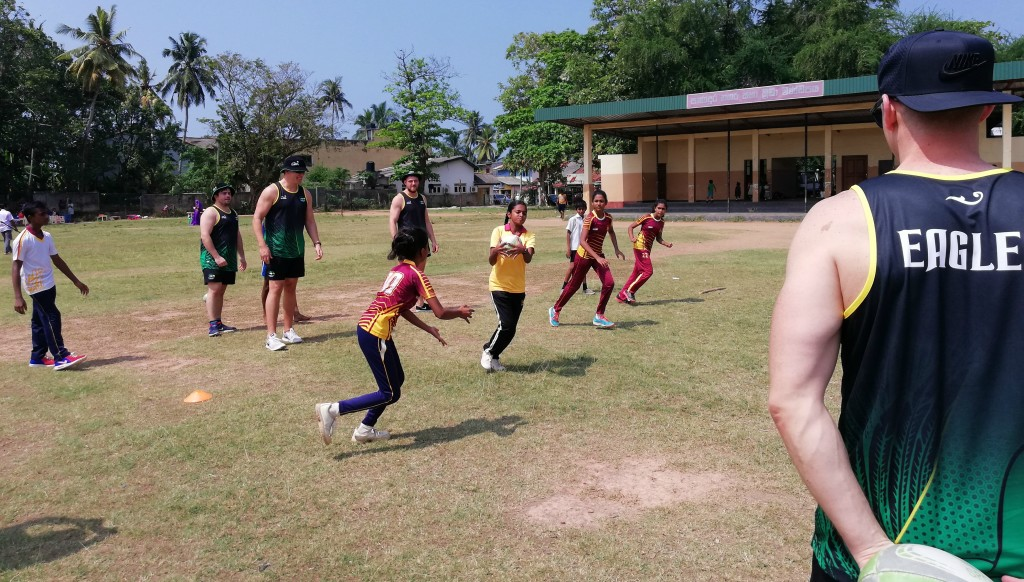 Pupils show Eagles' players their skills.
