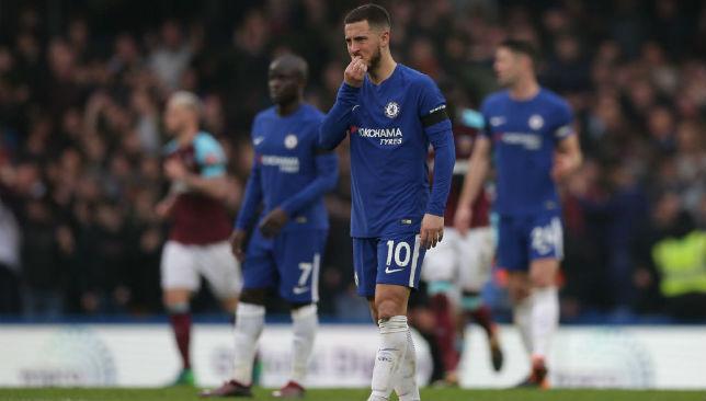 Eden Hazard reacts after Chelsea concede a goal.