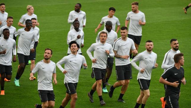 FC Salzburg players jog during a training session