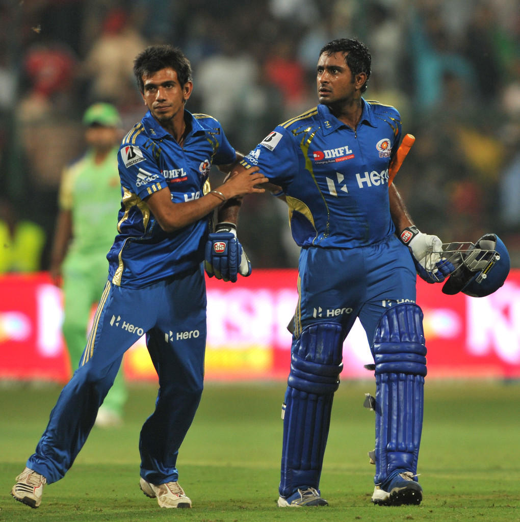 Mumbai Indians player Yuzvendra Chahal (L) tries to stop batsman Ambatti Rayadu from a confrontation with Royal Challengers Bangalore players after winning the IPL Twenty20 cricket match between Royal Challengers Bangalore and Mumbai Indians at the M. Chinnaswamy Stadium in Bangalore on May 14, 2012. RESTRICTED TO EDITORIAL USE. MOBILE USE WITHIN NEWS PACKAGE. AFP PHOTO/Manjunath KIRAN (Photo credit should read Manjunath Kiran/AFP/GettyImages)