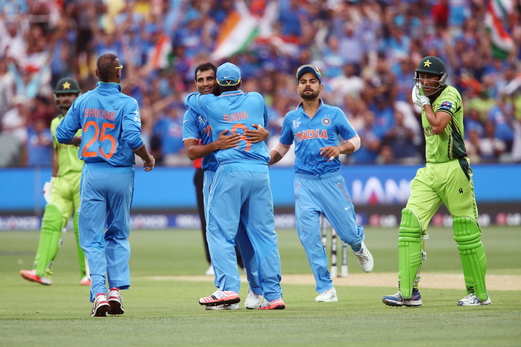 ADELAIDE, AUSTRALIA - FEBRUARY 15: Mohammed Shami of India is congratulated by teammates after he got the wicket of Younus Khan of Pakistan during the 2015 ICC Cricket World Cup match between India and Pakistan at Adelaide Oval on February 15, 2015 in Adelaide, Australia. (Photo by Morne de Klerk/Getty Images)