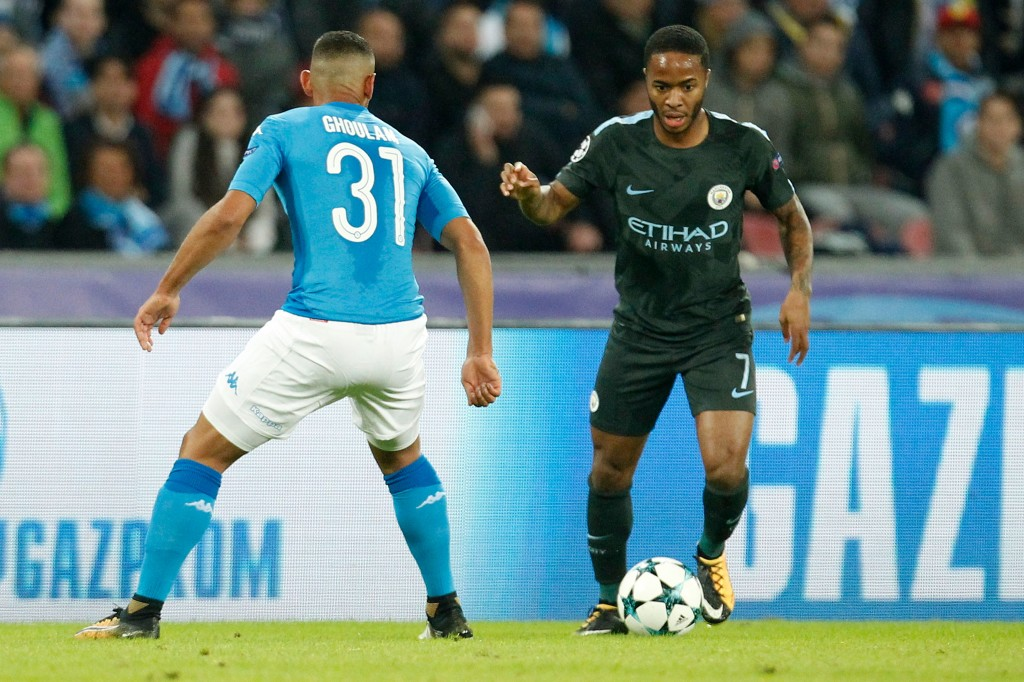 Manchester City's English midfielder Raheem Sterling (R) vies with Napoli's defender from Algeria Faouzi Ghoulam during the UEFA Champions League football match Napoli vs Manchester City on November 1, 2017 at the San Paolo stadium in Naples. / AFP PHOTO / Carlo Hermann (Photo credit should read CARLO HERMANN/AFP/Getty Images)