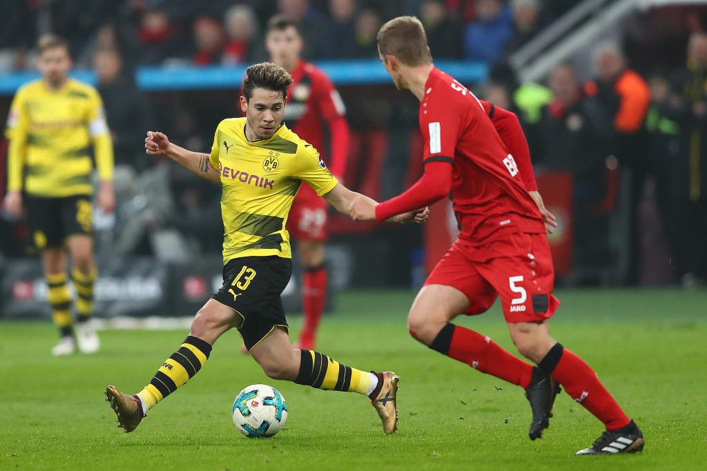 LEVERKUSEN, GERMANY - DECEMBER 02: Raphael Guerreiro of Dortmund (13) fights for the ball with Sven Bender of Bayer Leverkusen during the Bundesliga match between Bayer 04 Leverkusen and Borussia Dortmund at BayArena on December 2, 2017 in Leverkusen, Germany. (Photo by Dean Mouhtaropoulos/Bongarts/Getty Images)