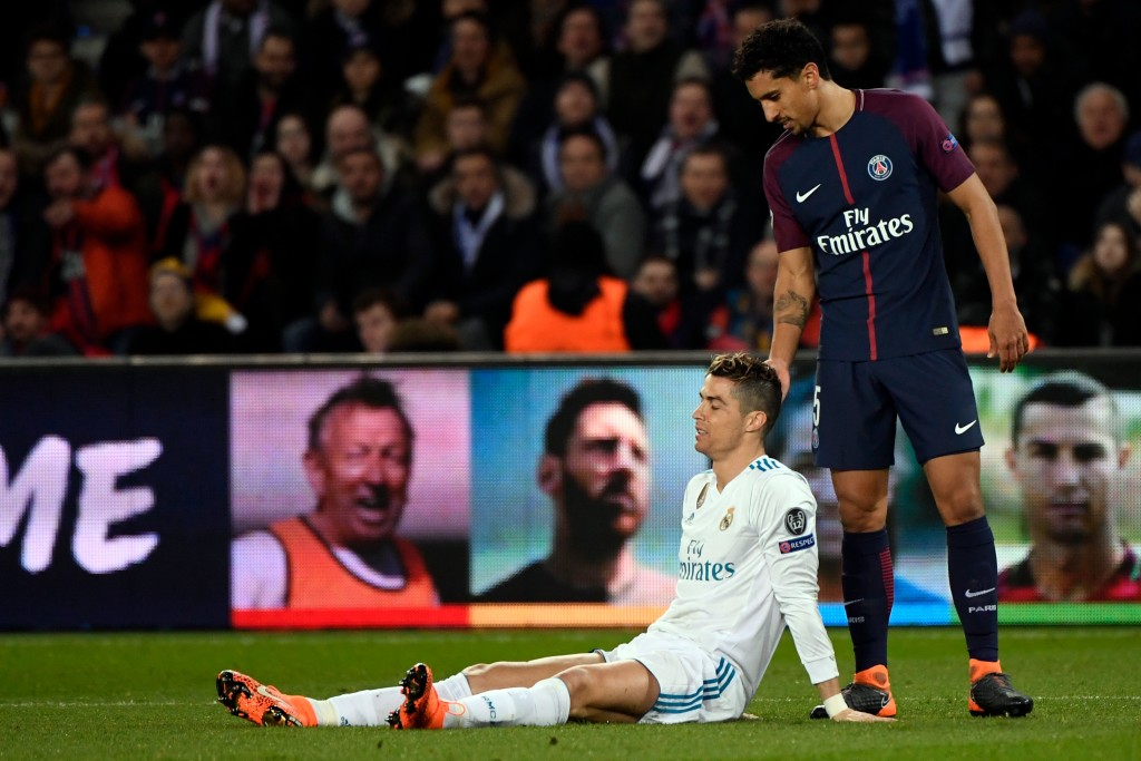 Real Madrid's Portuguese forward Cristiano Ronaldo (L) reacts next to Paris Saint-Germain's Brazilian defender Marquinhos during the UEFA Champions League round of 16 second leg football match between Paris Saint-Germain (PSG) and Real Madrid on March 6, 2018, at the Parc des Princes stadium in Paris. / AFP PHOTO / PIERRE-PHILIPPE MARCOU (Photo credit should read PIERRE-PHILIPPE MARCOU/AFP/Getty Images)