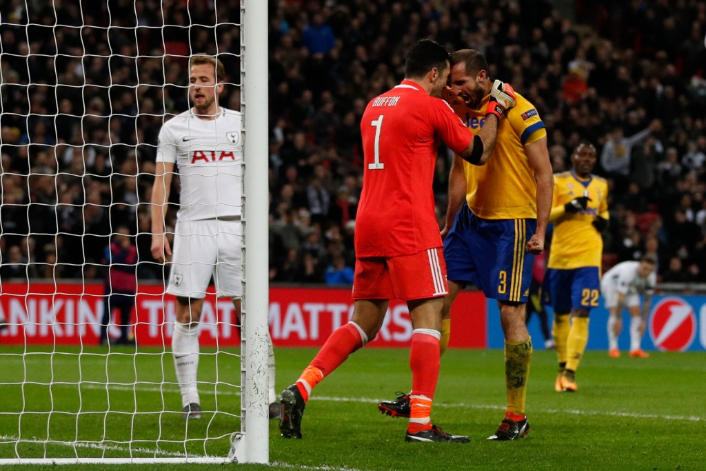 Juventus defender Giorgio Chiellini (r) reacts with goalkeeper Gianluigi Buffon (l) after making an interception at Wembley.