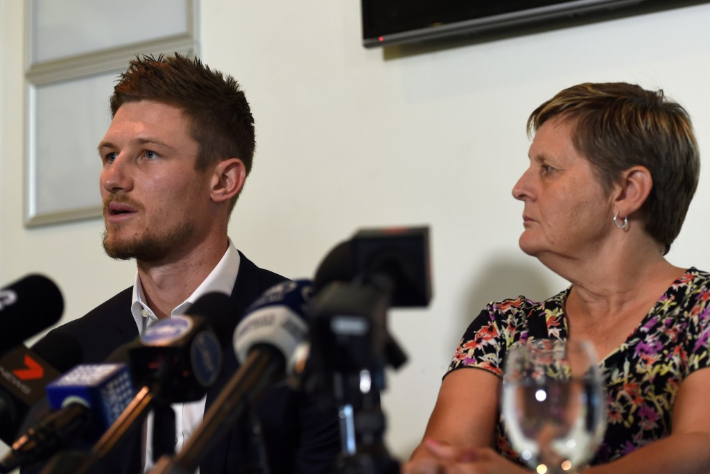 An emotional Cameron Bancroft (l) asked for forgiveness about his part in ball-tampering scandal.
