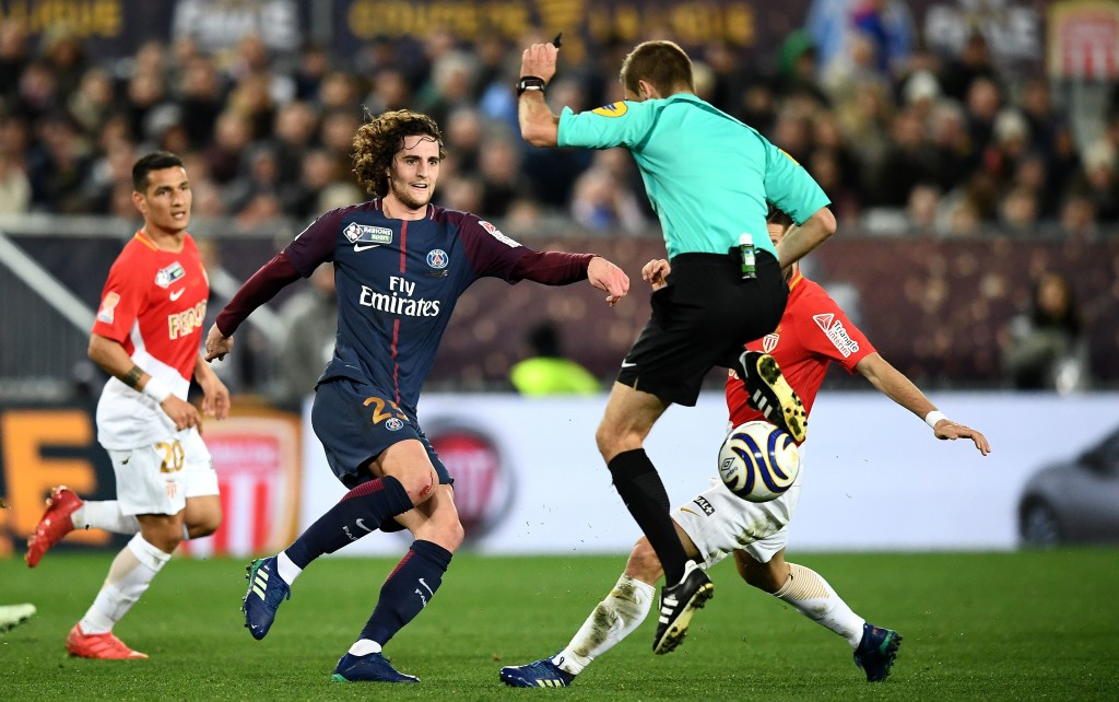 Paris Saint-Germain's French midfielder Adrien Rabiot (L) plays the ball next to French referee Clement Turpin (R) during the French League Cup final football match between Monaco (ASM) and Paris Saint-Germain (PSG) at The Matmut Atlantique Stadium in Bordeaux, southwestern France on March 31, 2018. / AFP PHOTO / FRANCK FIFE (Photo credit should read FRANCK FIFE/AFP/Getty Images)