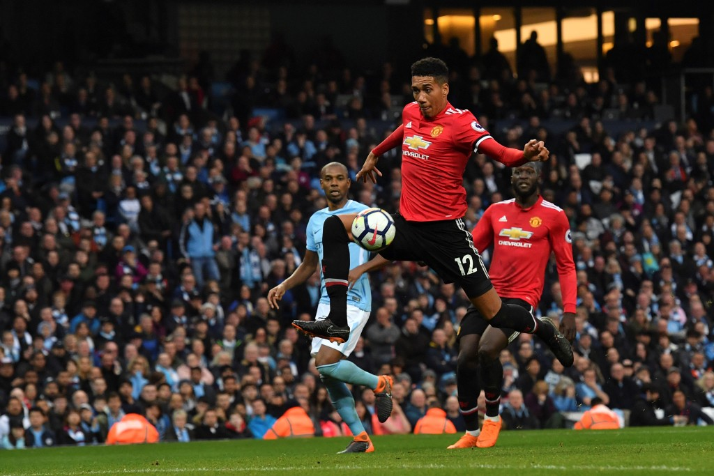 Manchester United defender Chris Smalling scores his team's third goal.