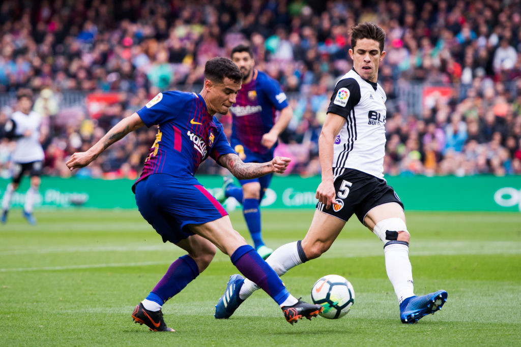 Philippe Coutinho (L) made the difference for Barcelona.