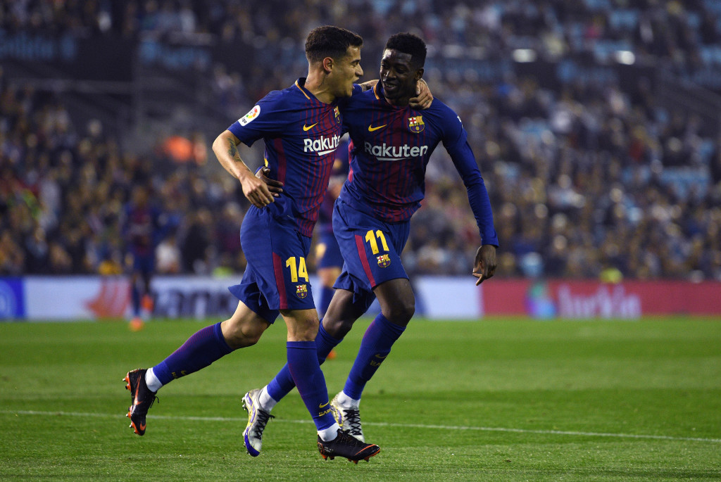 VIGO, SPAIN - APRIL 17: Ousmane Dembele (R) celebrates with Philippe Coutinho of Barcelona after scores the first goal during the La Liga match between Celta de Vigo and Barcelona at Municipal Balaidos on April 17, 2018 in Vigo, Spain. (Photo by Octavio Passos/Getty Images)