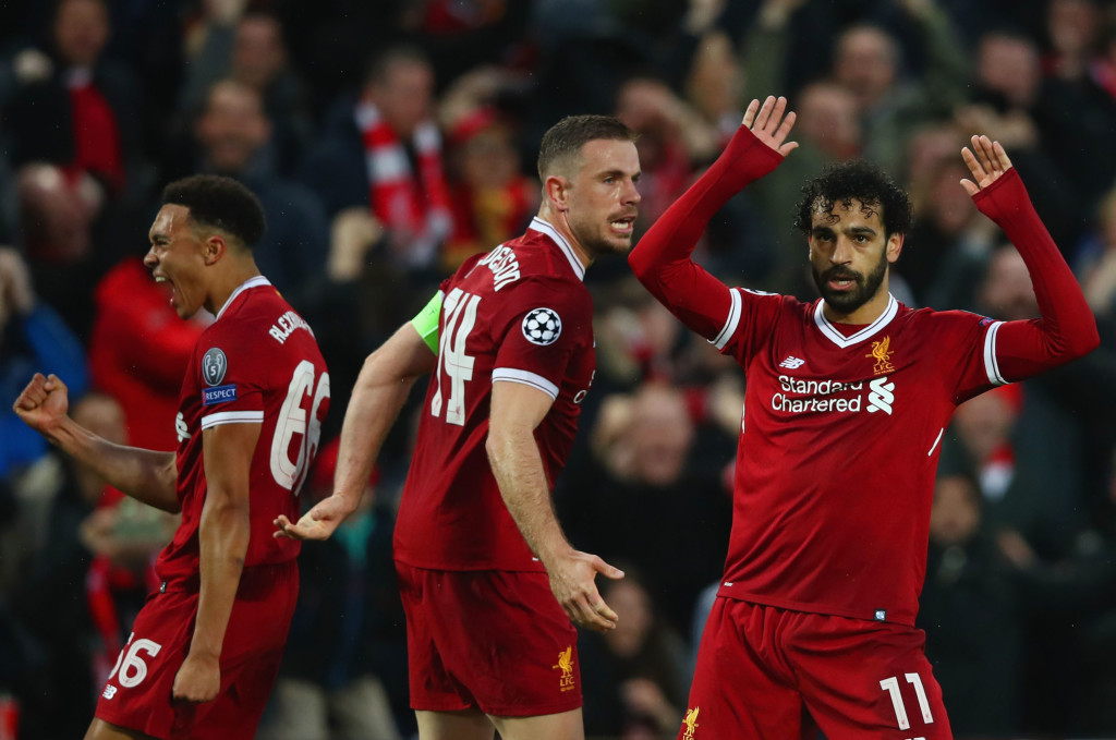 LIVERPOOL, ENGLAND - APRIL 24: Mohamed Salah of Liverpool (11) celebrates after scoring his sides first goal with team mates Jordan Henderson and Trent Alex Arnold of Liverpool during the UEFA Champions League Semi Final First Leg match between Liverpool and A.S. Roma at Anfield on April 24, 2018 in Liverpool, United Kingdom. (Photo by Clive Brunskill/Getty Images)