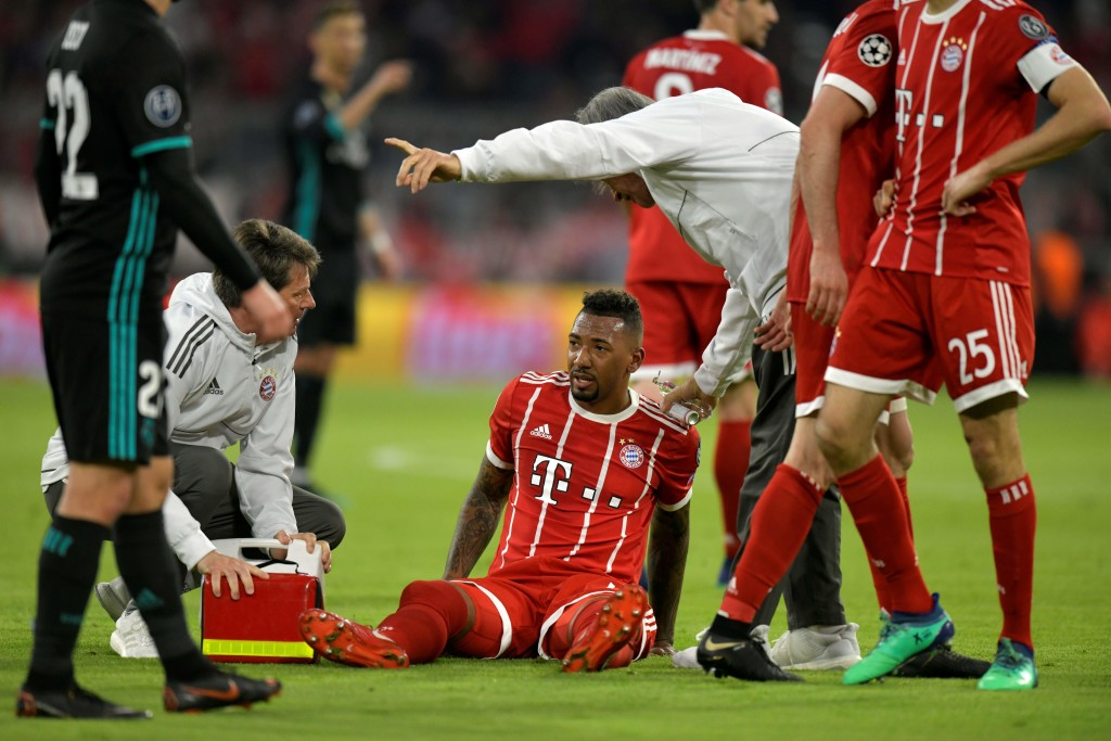 Bayern Munich's German defender Jerome Boateng receives medical care after being injured during the UEFA Champions League semi-final first-leg football match FC Bayern Munich v Real Madrid CF in Munich, southern Germany on April 25, 2018. (Photo by GUENTER SCHIFFMANN / AFP) (Photo credit should read GUENTER SCHIFFMANN/AFP/Getty Images)