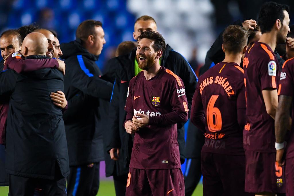 Lionel Messi of FC Barcelona celebrates with his team mates winning La Liga title after the La Liga match between Deportivo La Coruna and Barcelona at Estadio Riazor on April 29, 2018 in La Coruna, Spain.