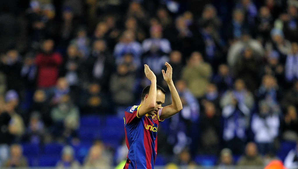 Andres Iniesta is applauded off by Espanyol fans.