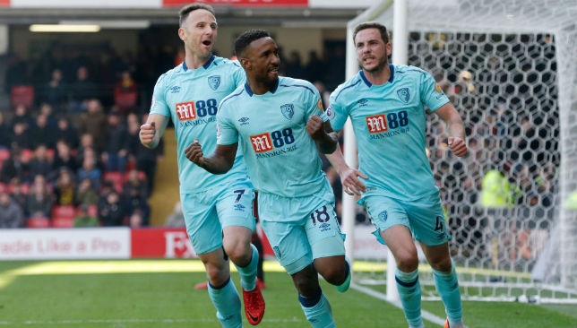 Jermain Defoe celebrates a goal with his Bournemouth team mates.