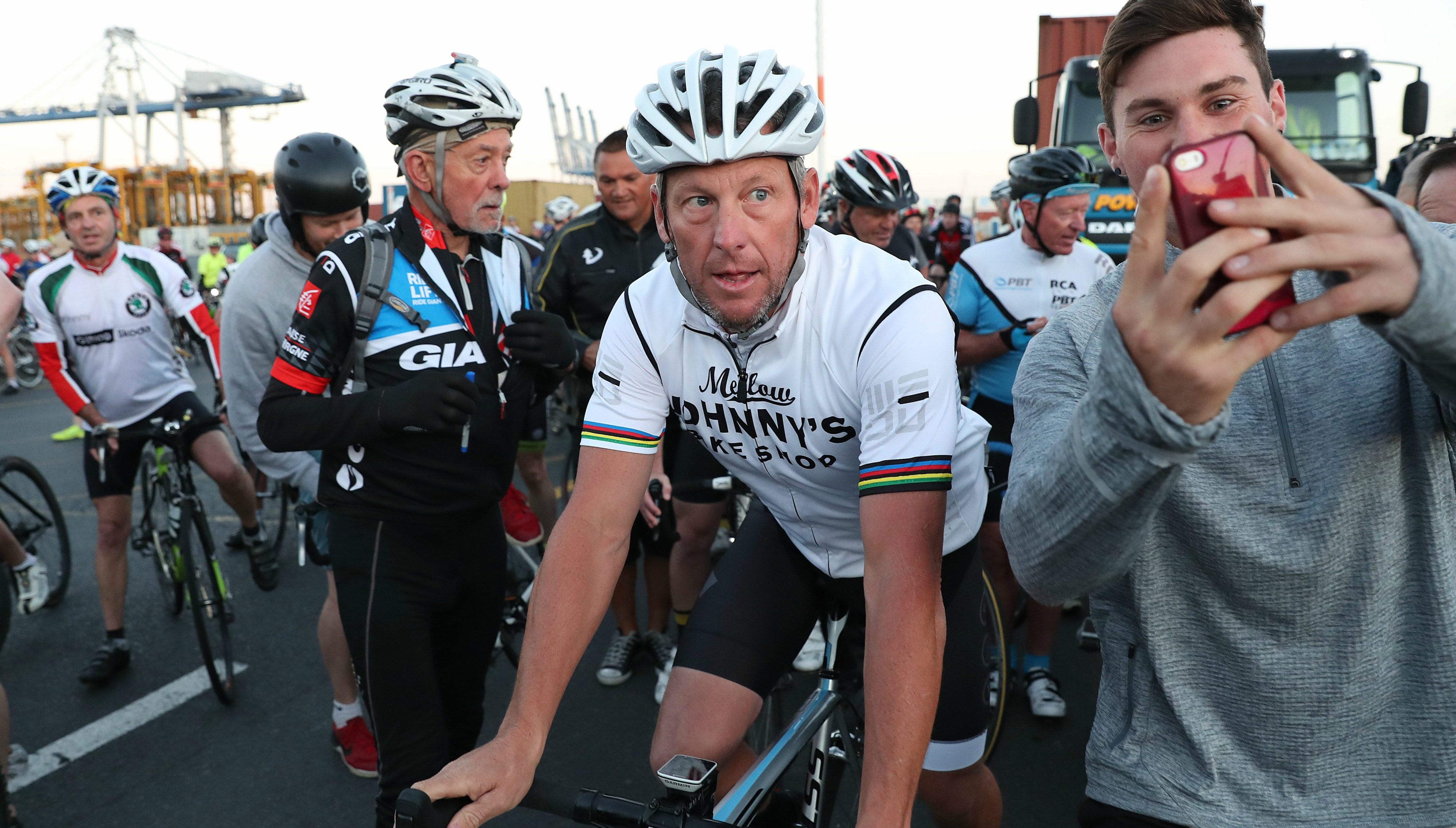 Lance Armstrong settles lawsuit with U.S. government, former teammate