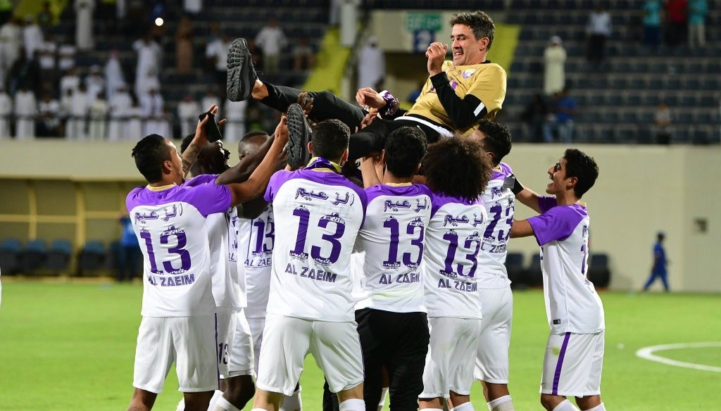 Zoran Mamic is hoisted high by his players.