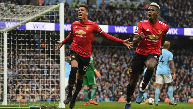 Chris Smalling celebrates scoring United's winner at City.